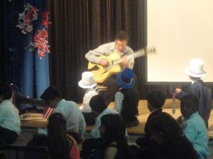 Students listening to Jazz guitarist Louis Vignapiano playing the guitar so beautifully. They wrote lyrics to his original music during the second grade. They sang and danced to these original songs during the show.